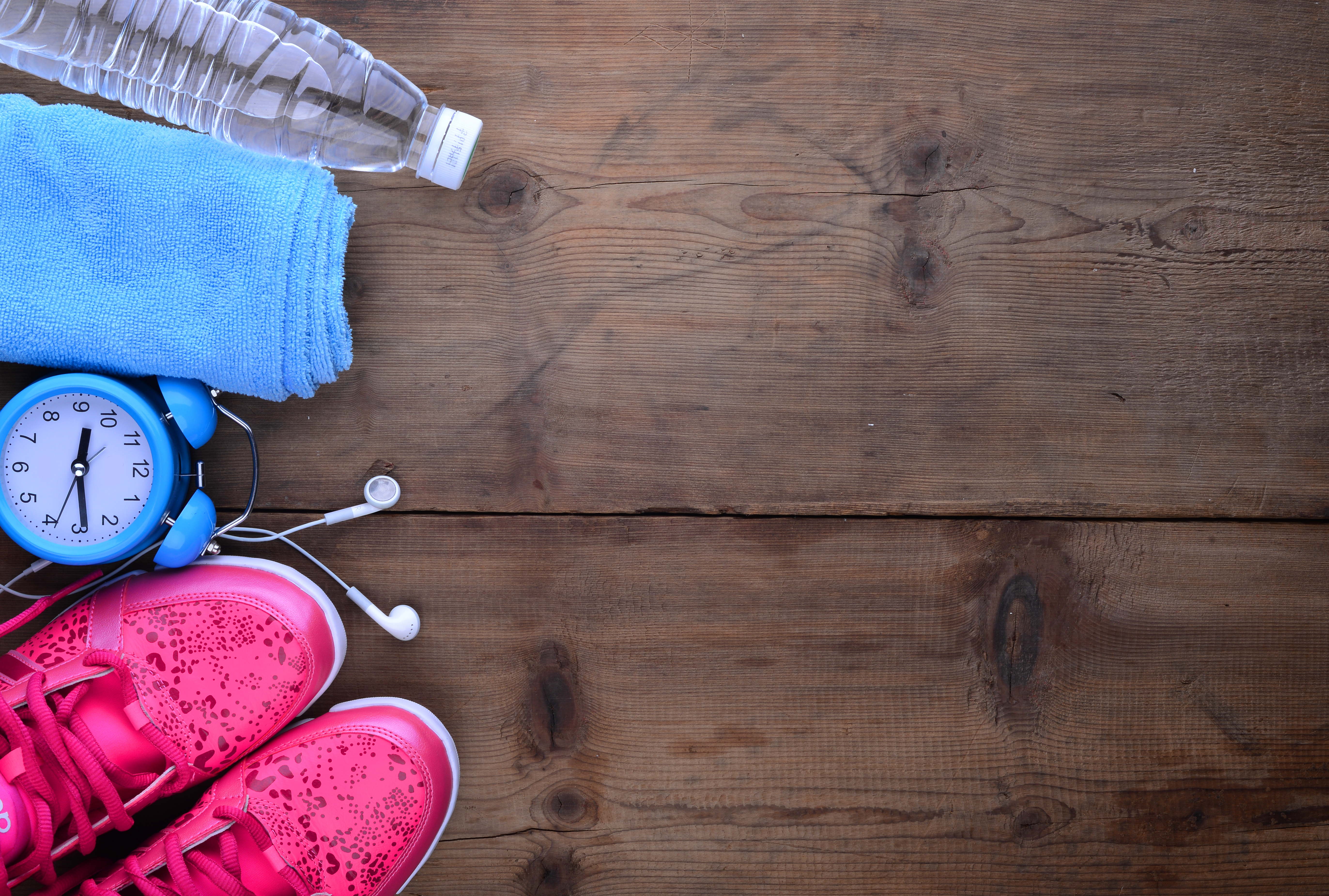 Fitness and sport equipment : Measuring tape,mat.sneakers,towel,bottle of water with wooden background on top view
